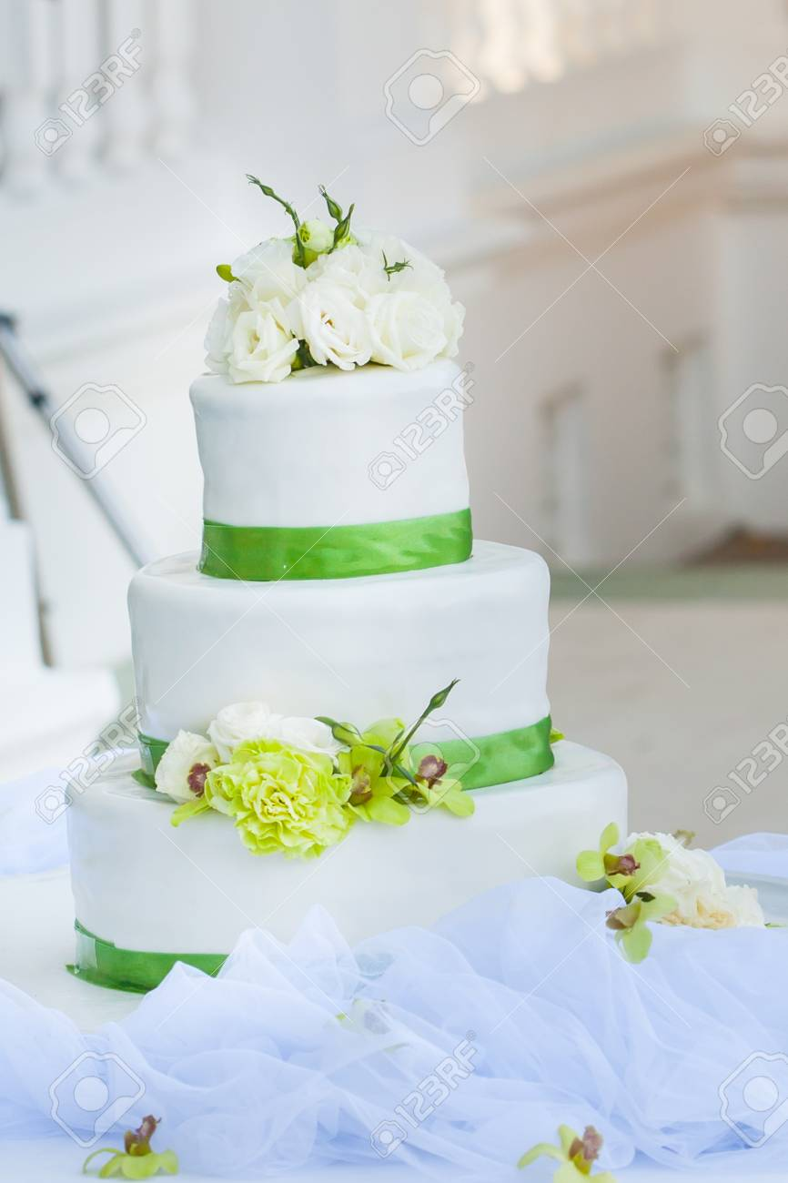 White Wedding Cake With Real Roses Decorations Stock Photo, Picture ...