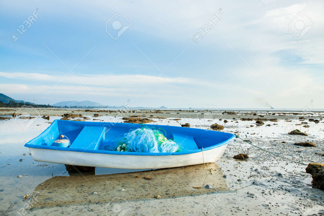 Small Fishing Boat on Sand Beach Background - 158379876