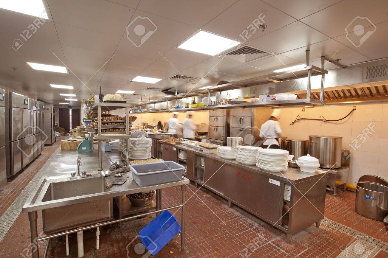 Chef cooking at commercial kitchen - hot job Stock Photo - 16782481