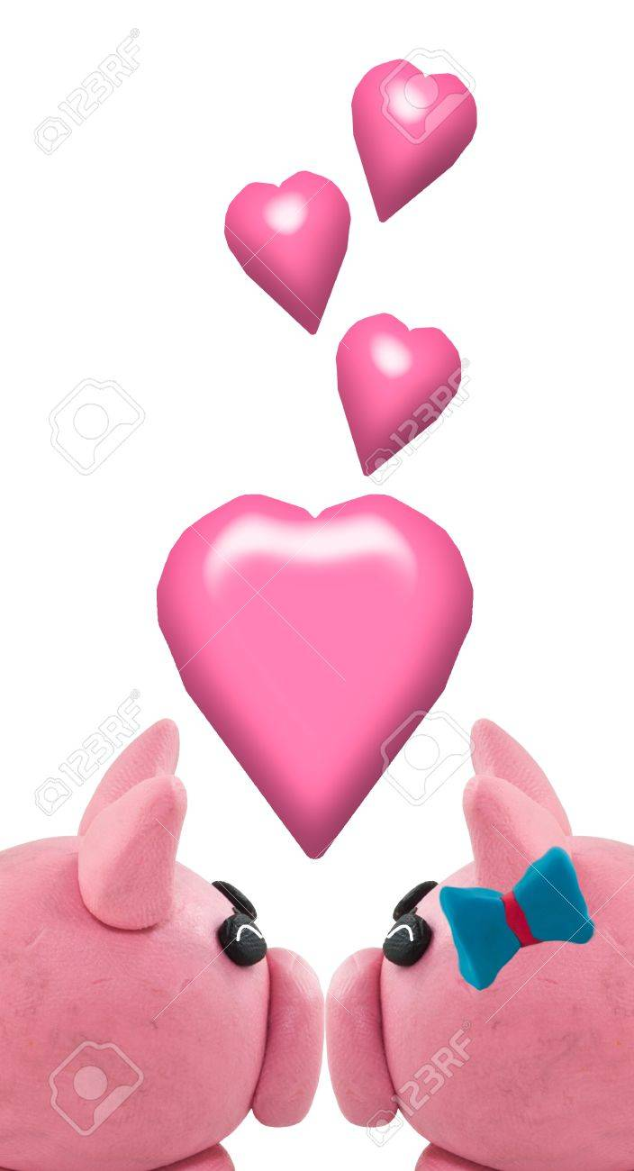 Pig made from clay in kissing. It is meaning love by kissing. Stock Photo - 16107566