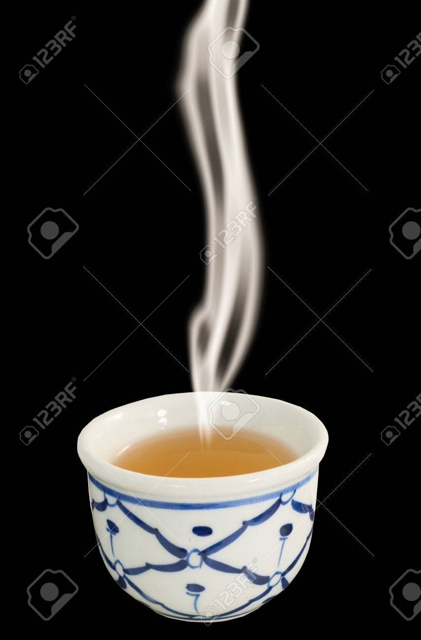 white chinese tea cup on black background with smoke stock photo