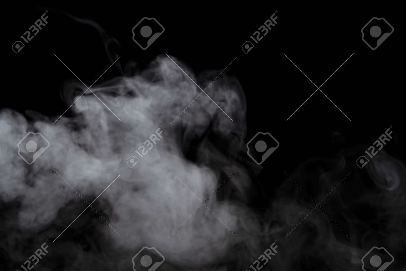 Abstract powder or smoke effect isolated on black background,Out of focus - 121014556