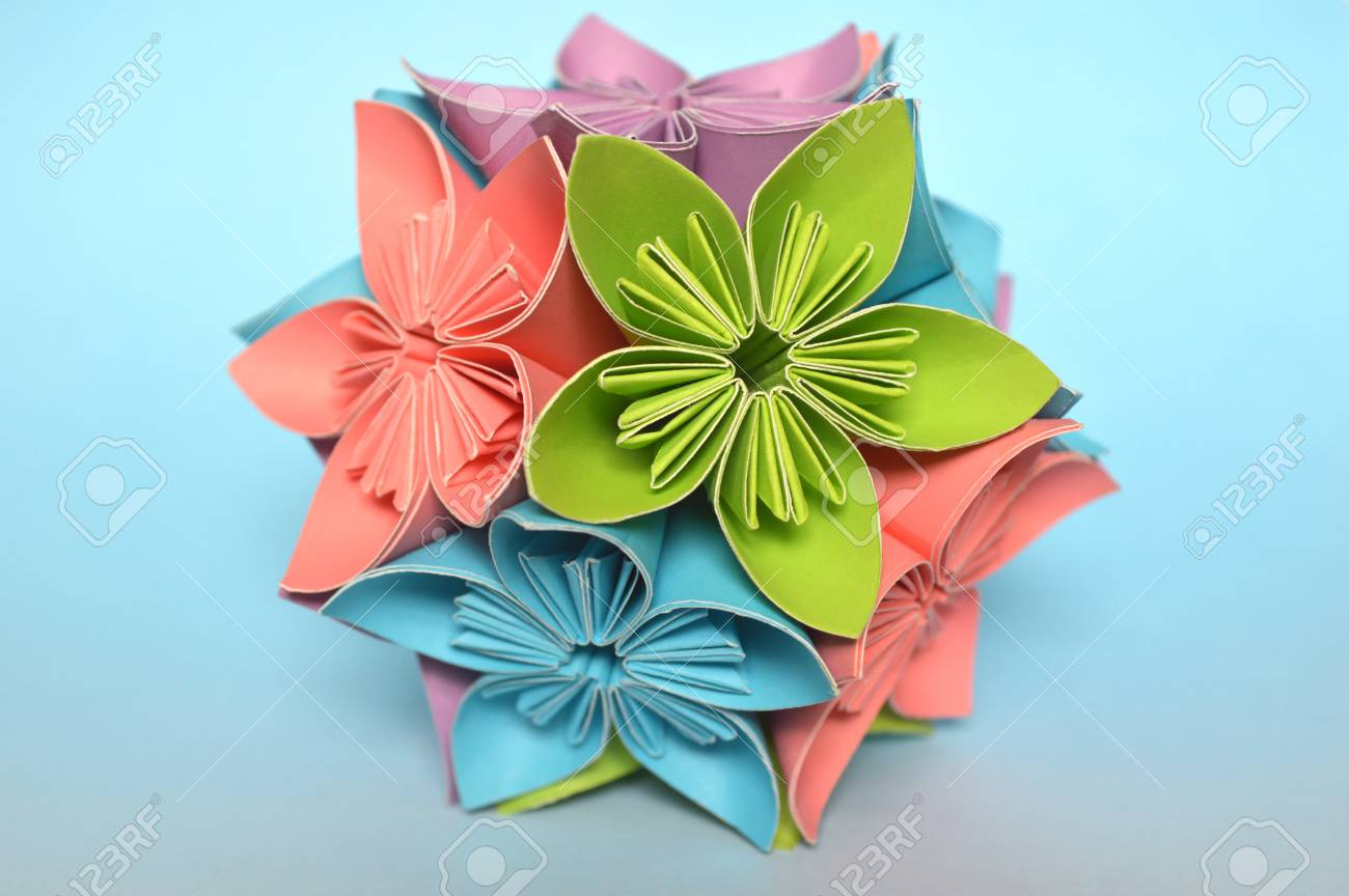 Fiori Kusudama.Origami Kusudama Flower Ball On Blue Background Stock Photo