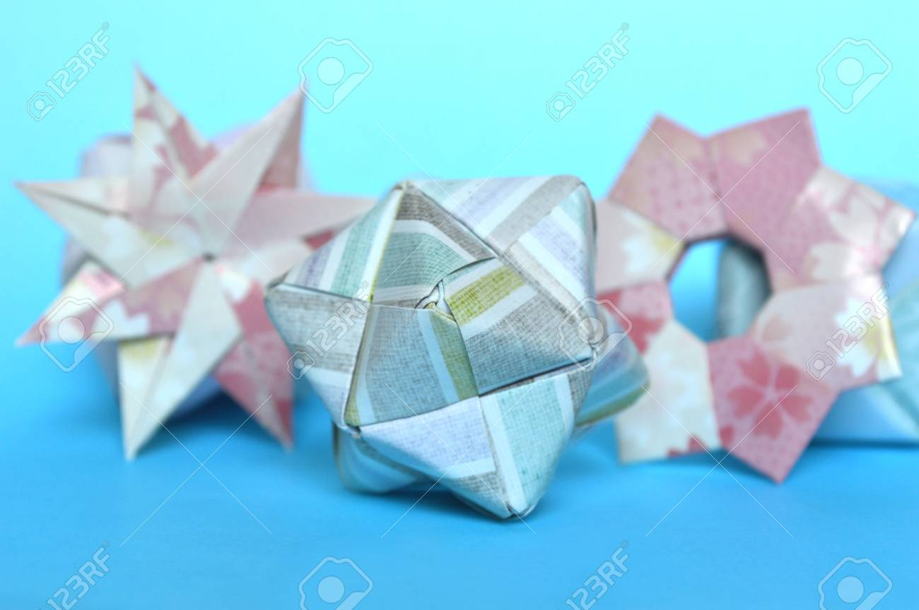 Modular Origami Star Ring And Sonobe Ball On Blue Background Stock