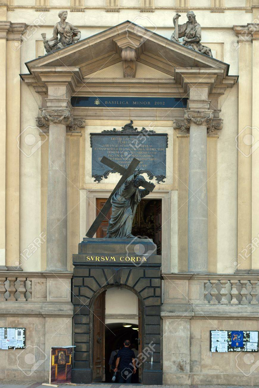 main entrance to the holy cross church with statue of jesus