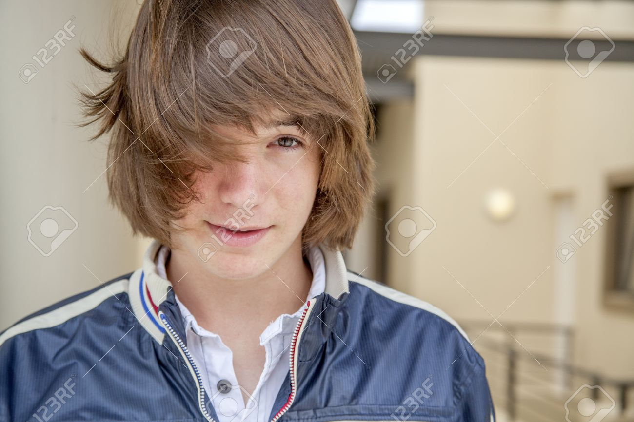 Close Up Of Teen Boy With Long Hair Stock Photo, Picture And ...