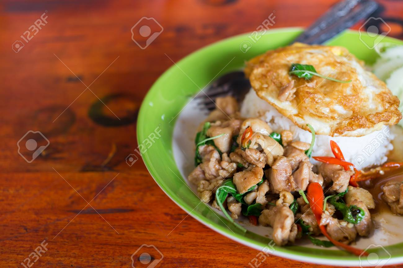 Thai spicy food basil chicken fried rice recipe with fried egg stock photo thai spicy food basil chicken fried rice recipe with fried egg forumfinder Image collections