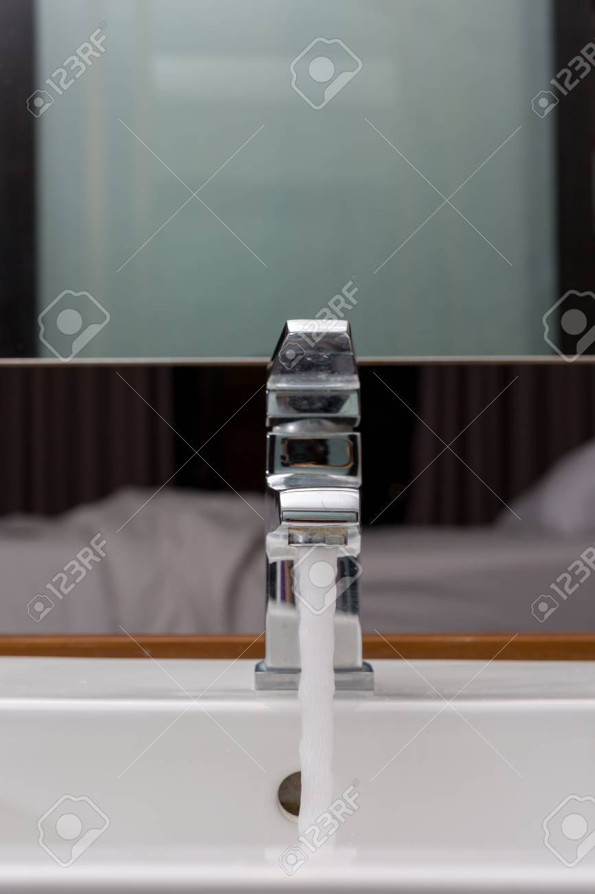 Faucet And Washbasin With Water Drop At Bathroom. Stock Photo ...