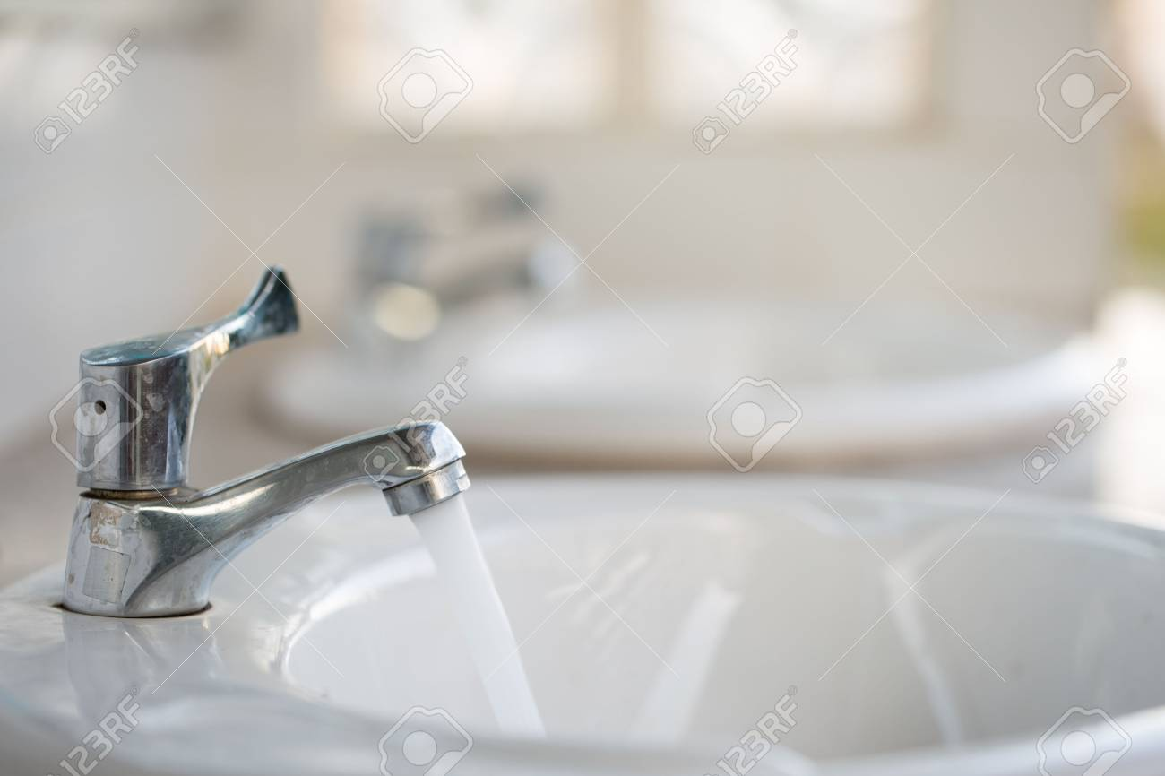 Faucet In The Public Toilet With Copy Space. Stock Photo, Picture ...