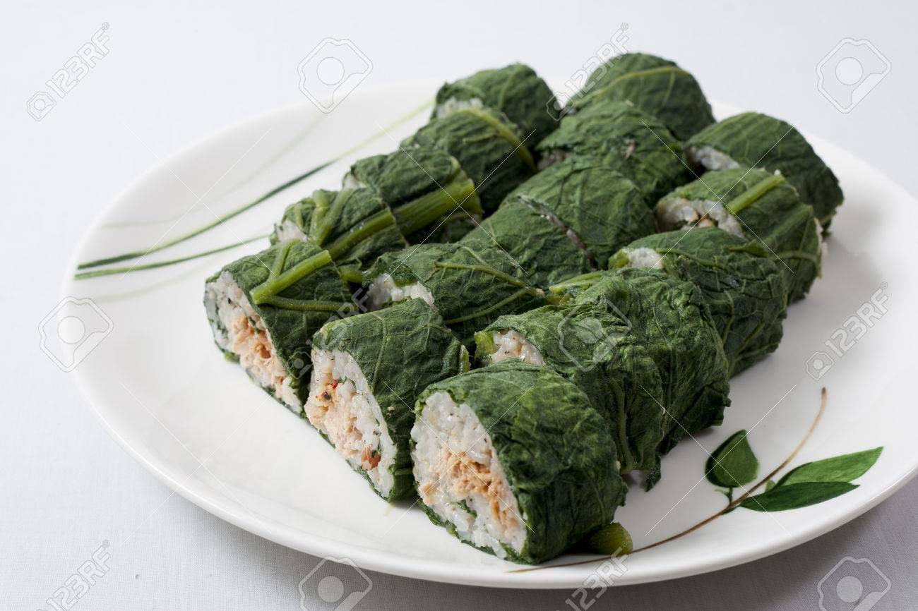 A Steam Pumpkin Leaf And Rice Spring Roll Decoration On The White