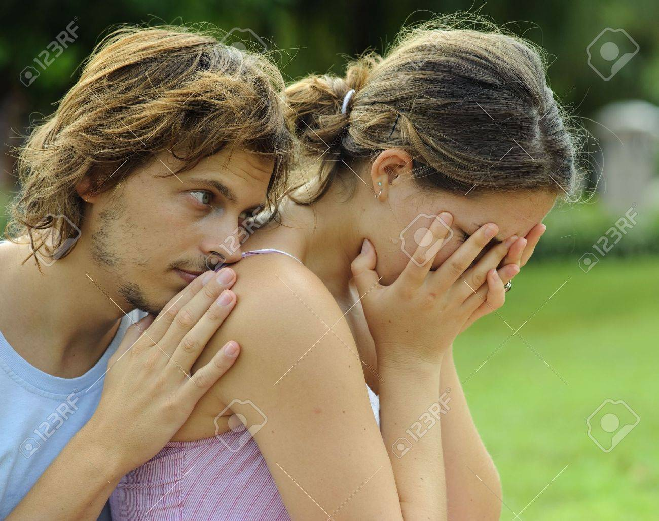 Man consoles his crying girlfriend in the park Stock Photo - 6677527