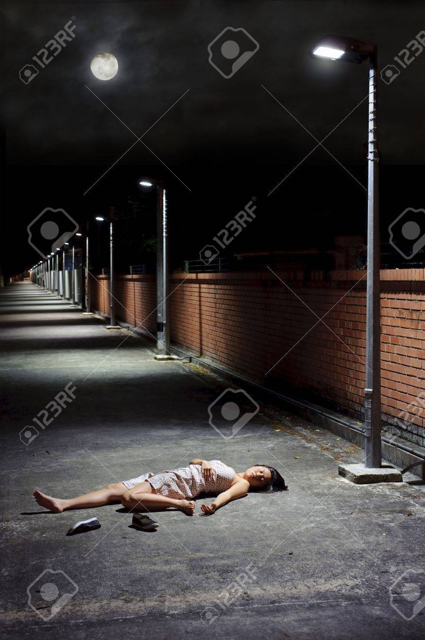 Woman lies vulnerable in the vacant street Stock Photo - 6733889