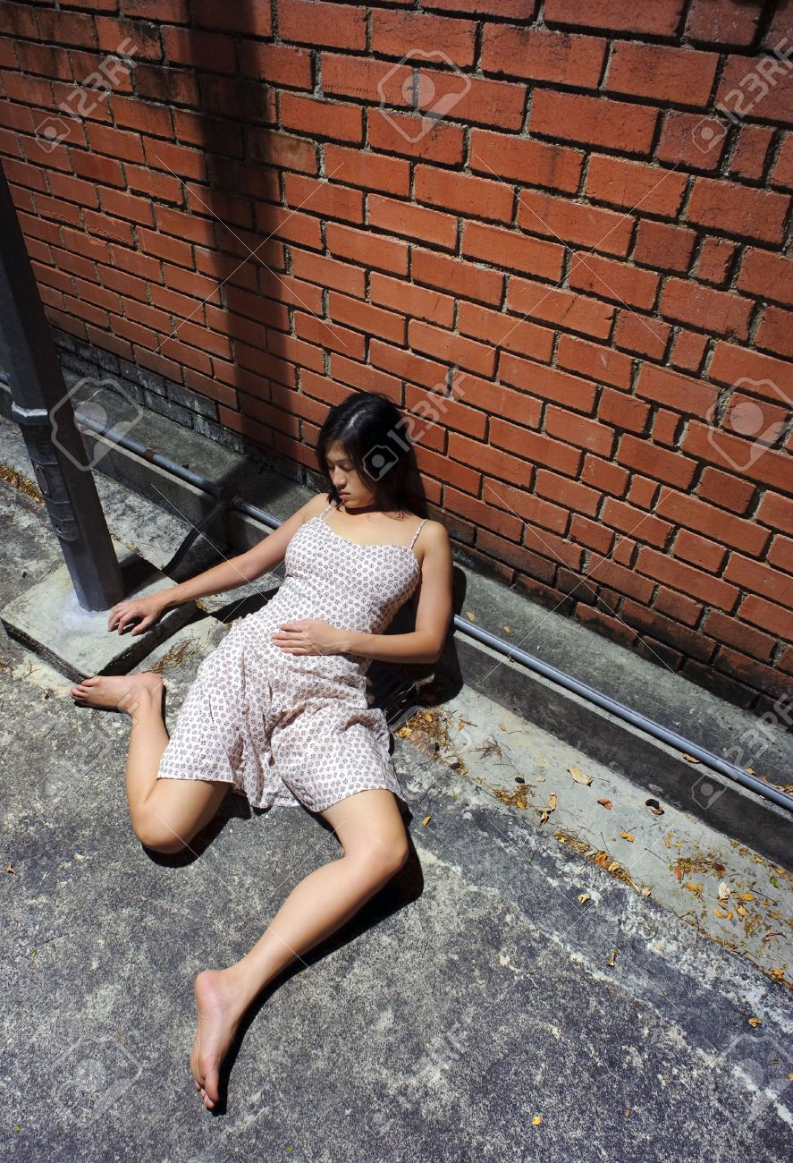 Asian girl is passed out in the gutter Stock Photo - 6800705