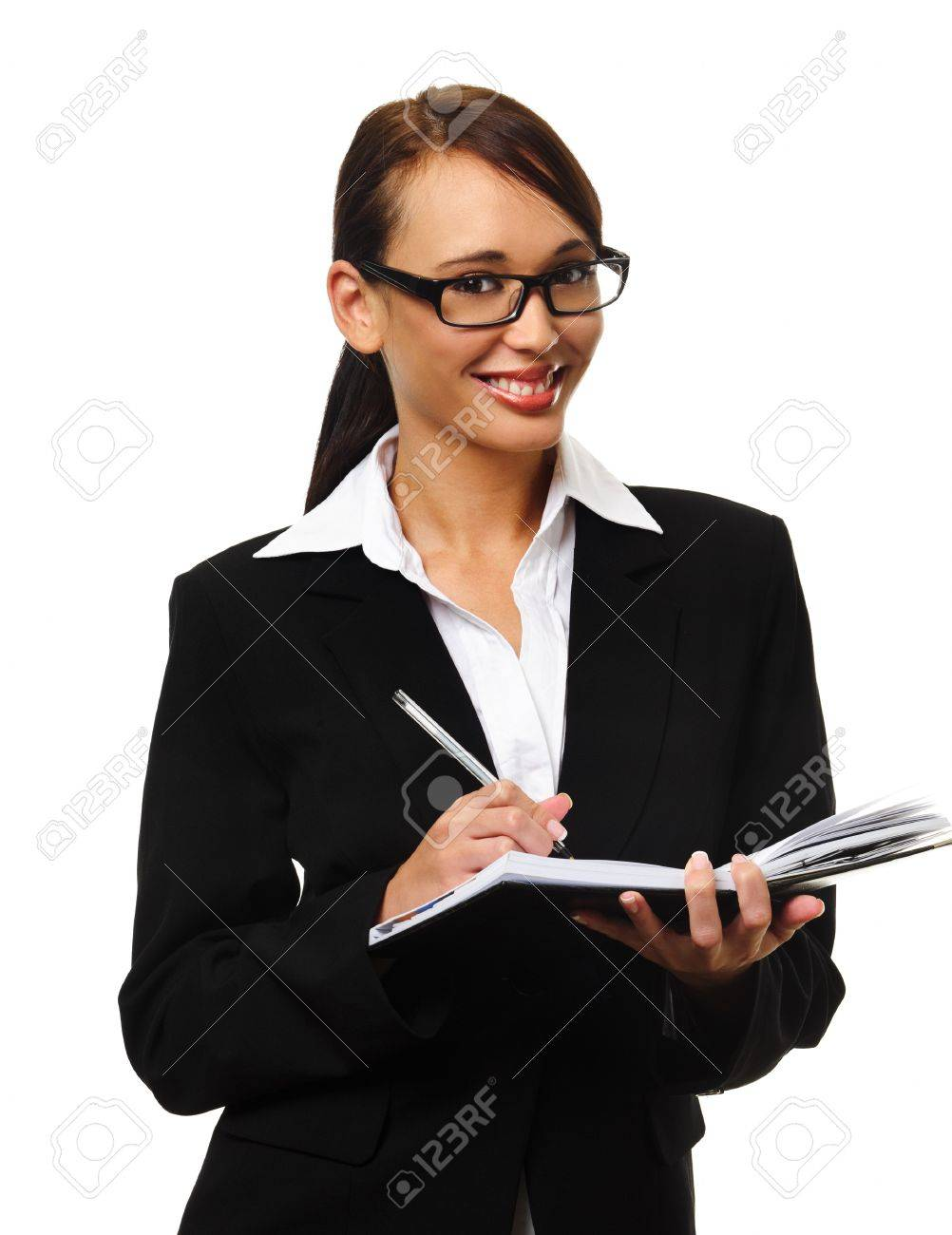 young successful career w writes in her personal organiser stock photo young successful career w writes in her personal organiser