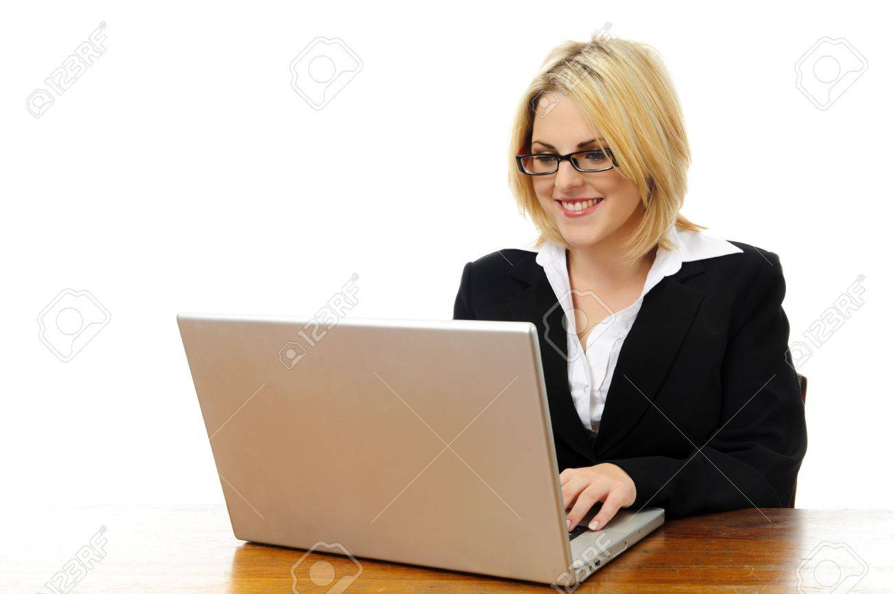 happy young successful w sitting at desk laptop isolated happy young successful w sitting at desk laptop isolated on white stock photo 7542154