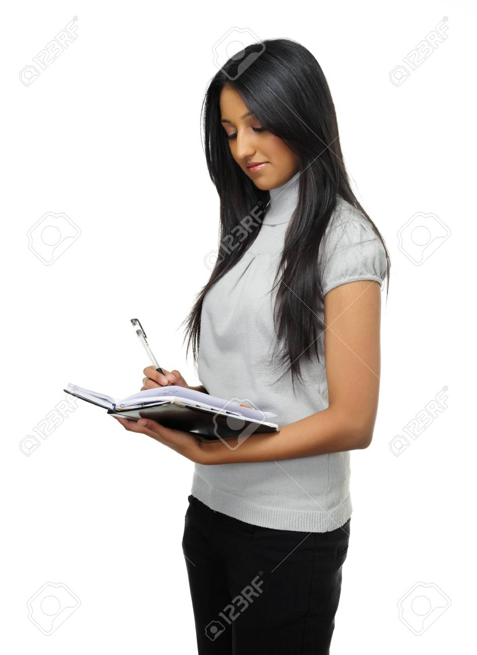 Asian girl writes in her diary in studio Stock Photo - 7786081