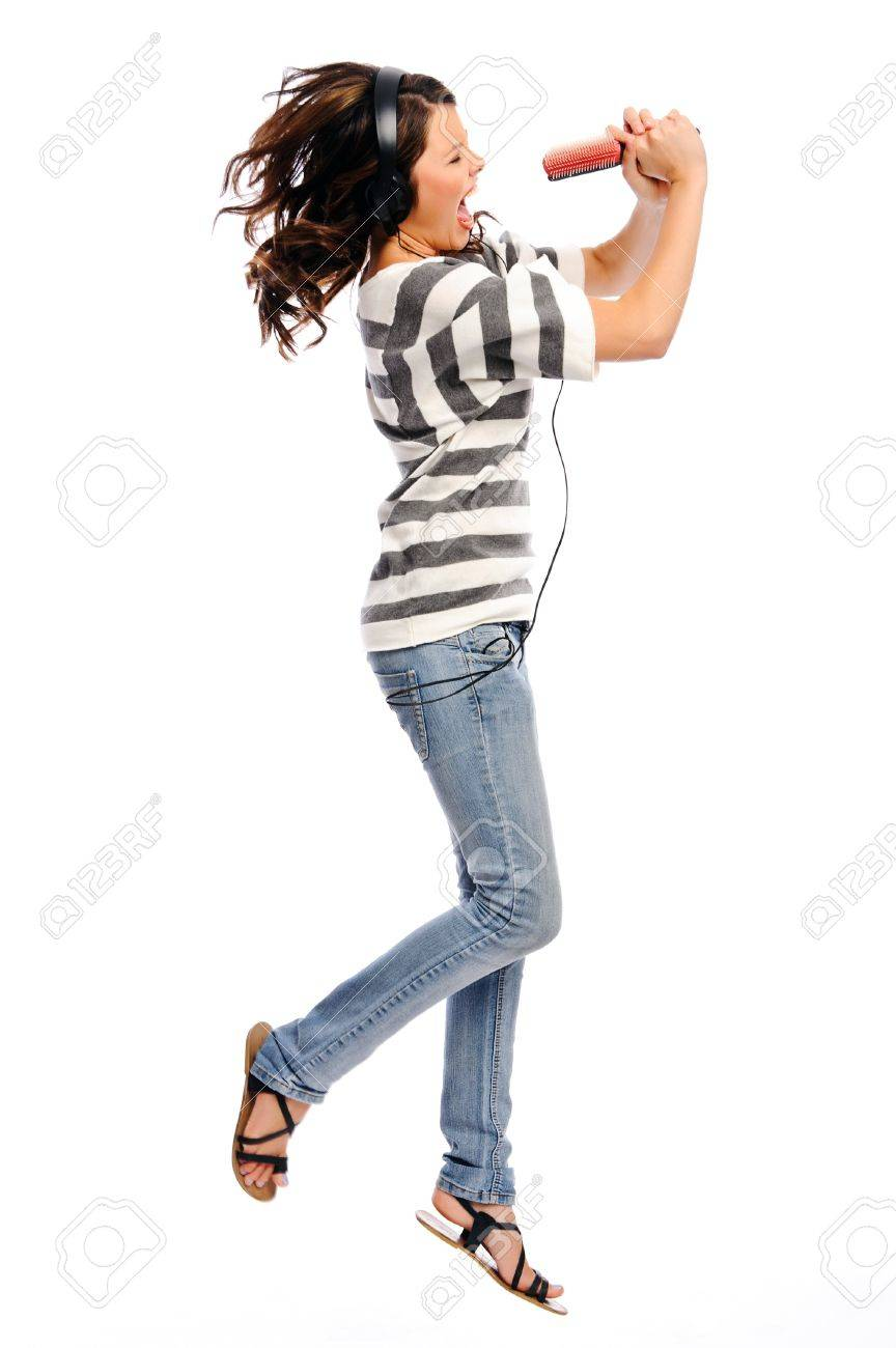 Attractive young woman jumps and pretend that she is a pop star Stock Photo - 8726064