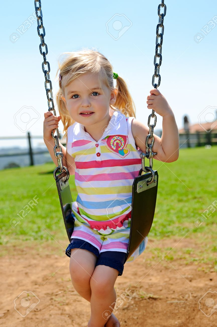 Young child on swing in playground outdoors Stock Photo - 8726883