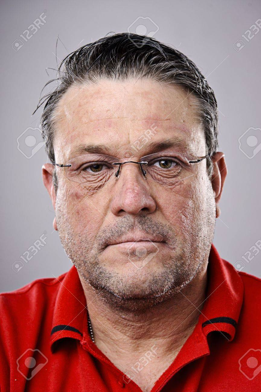 fine art portrait of a older brunette man with glasses stock photo