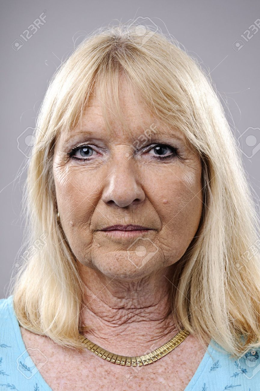 wrinkled blonde woman poses for a portrait in studio Stock Photo - 10142411