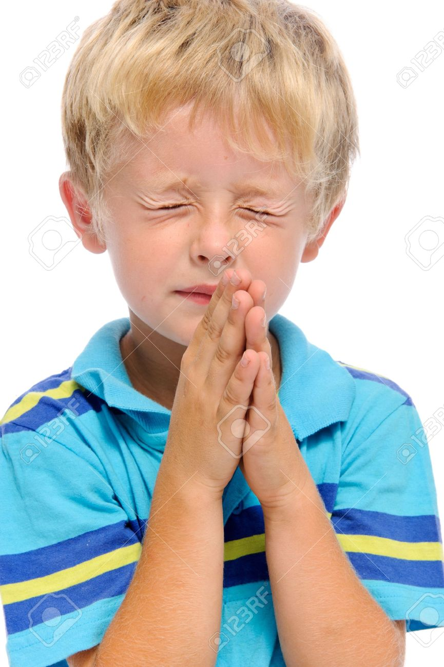 Young blonde child clasps his palms together in prayer, isolated on white Stock Photo - 10227759