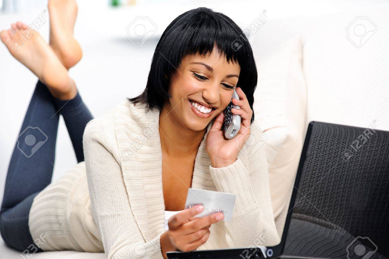 Woman is happy she can shop online and confirm her reservations over the phone Stock Photo - 10861446