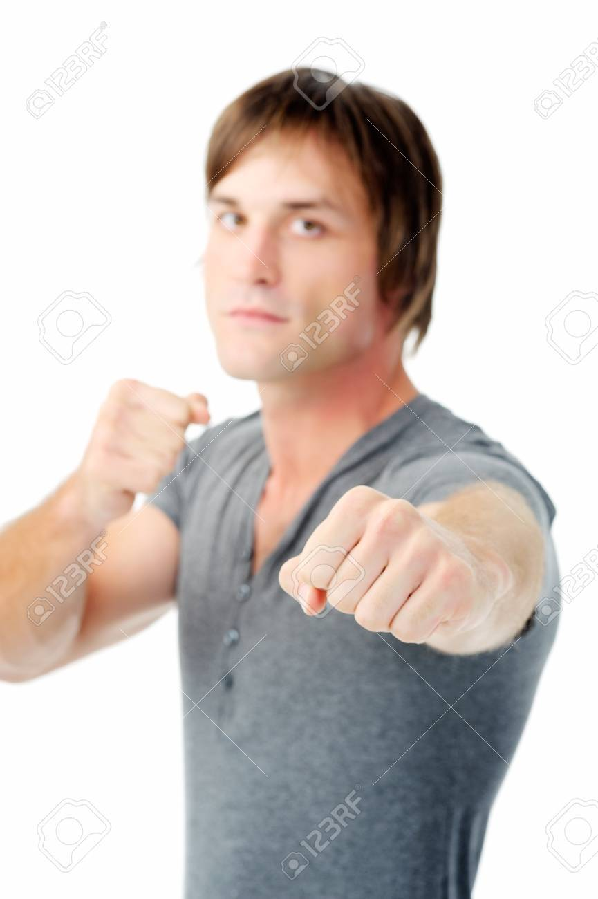 scary man with fists clenched boxing towards camera showing agression Stock Photo - 11900341