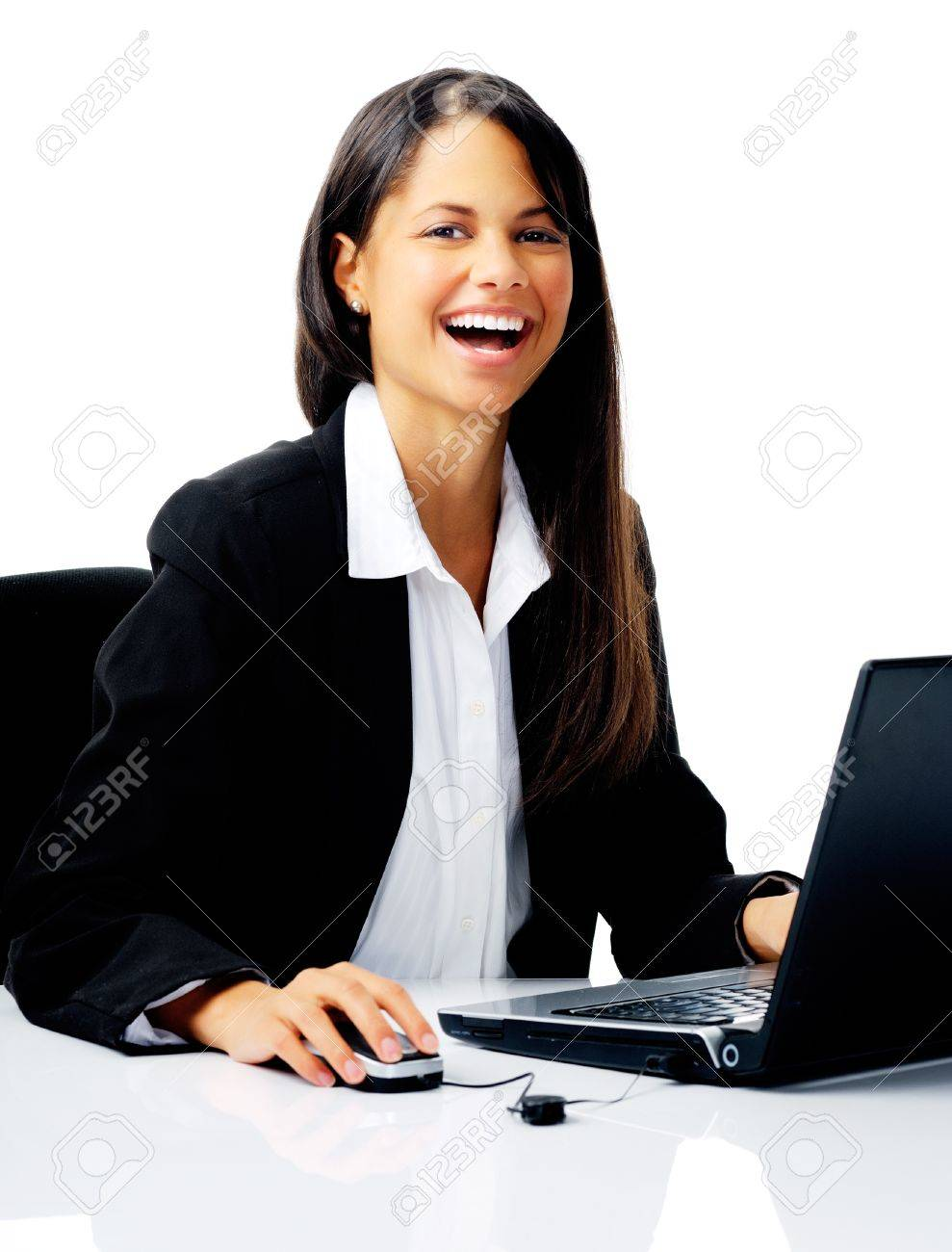 laughing businesswoman uses laptop at her desk, isolated on white Stock Photo - 12347441