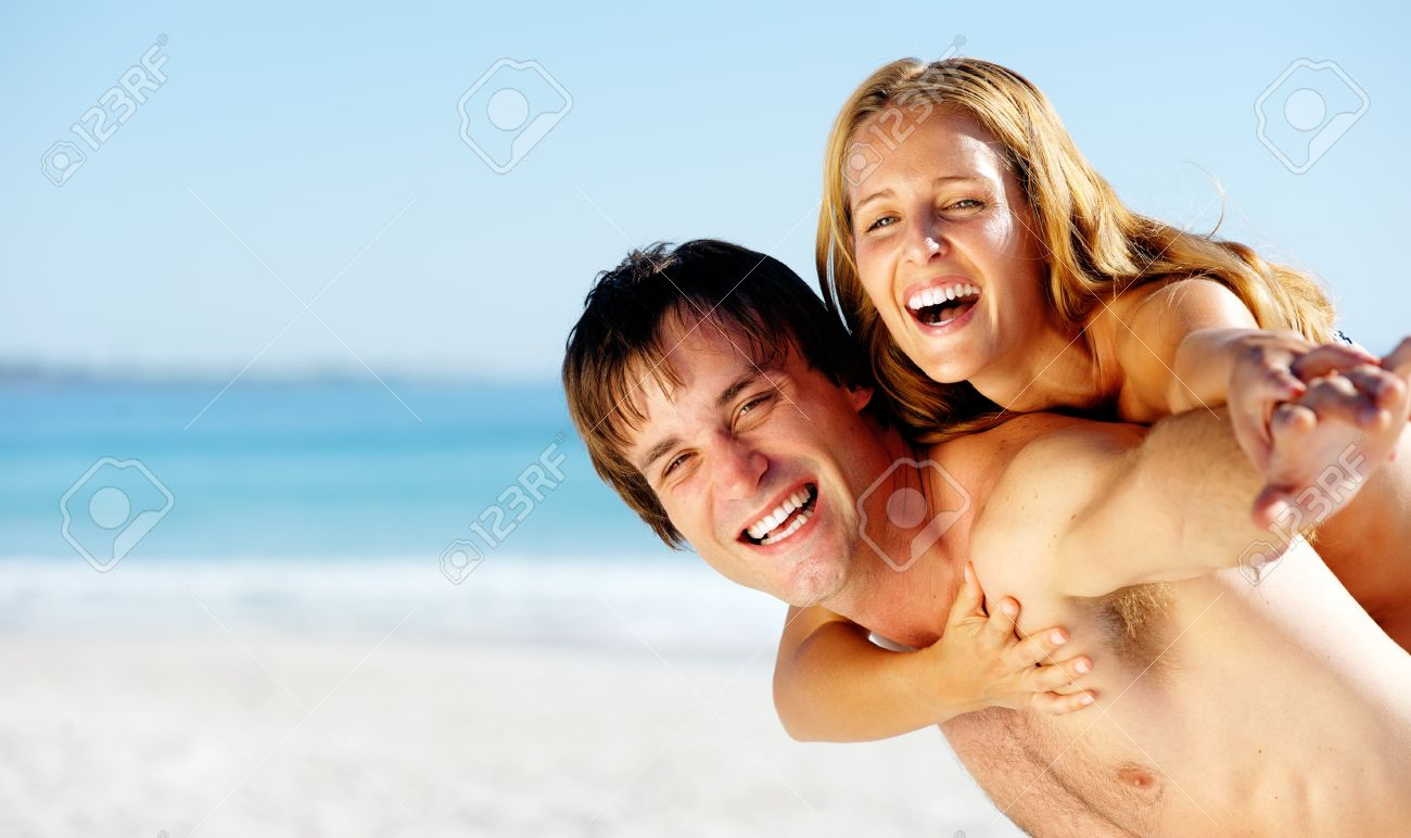 carefree couple embrace and enjoy some summer beach loving on a tropical island Stock Photo - 12753715