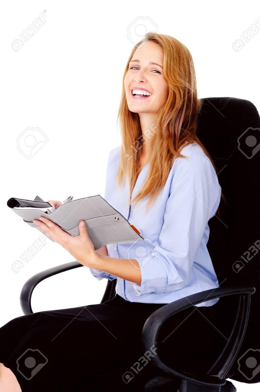beautiful business woman writing in her organizer Stock Photo - 13025927