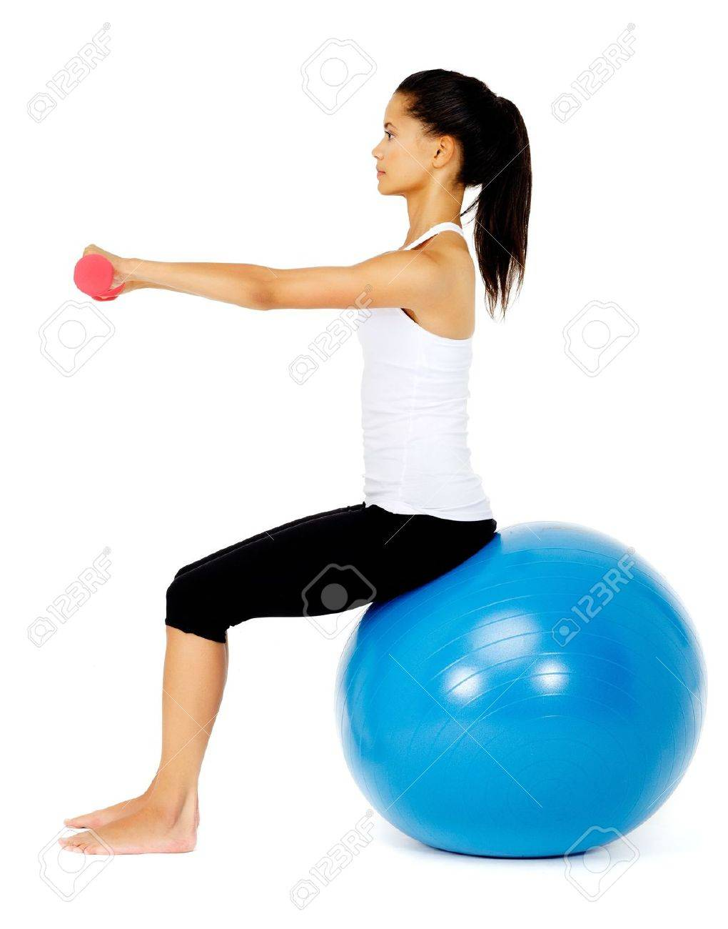Happy fit asian woman sitting on a gym ball while lifting dumbbells, isolated on white with pilates ball Stock Photo - 13183432