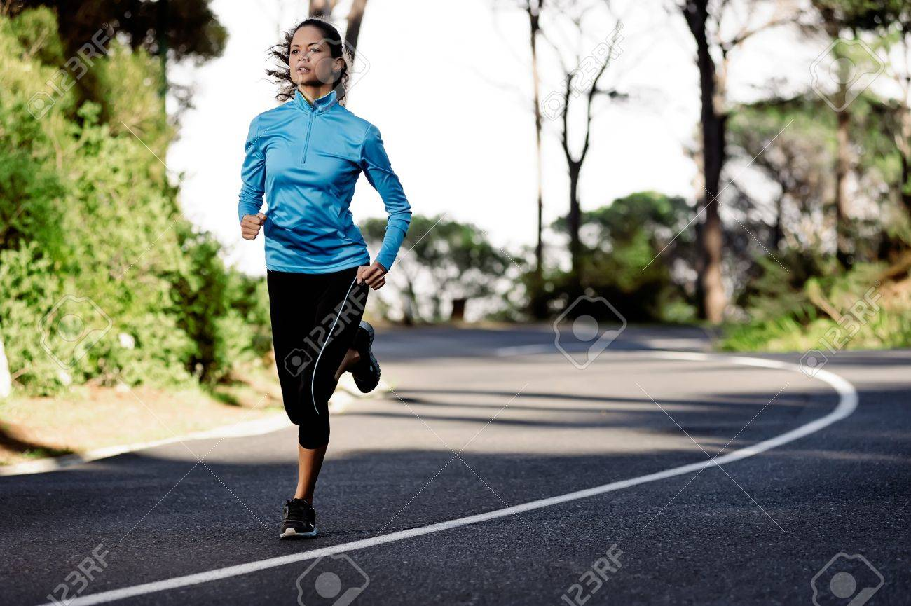 portrait of a healthy woman training for running along a mountain road alone. fitness wellness athlete Standard-Bild - 13883206