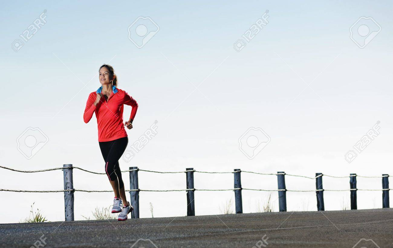 Athletic runner training alone on a road outdoors for marathon and fitness  healthy wellness exercise panorama with copyspace Stock Photo - 14342122