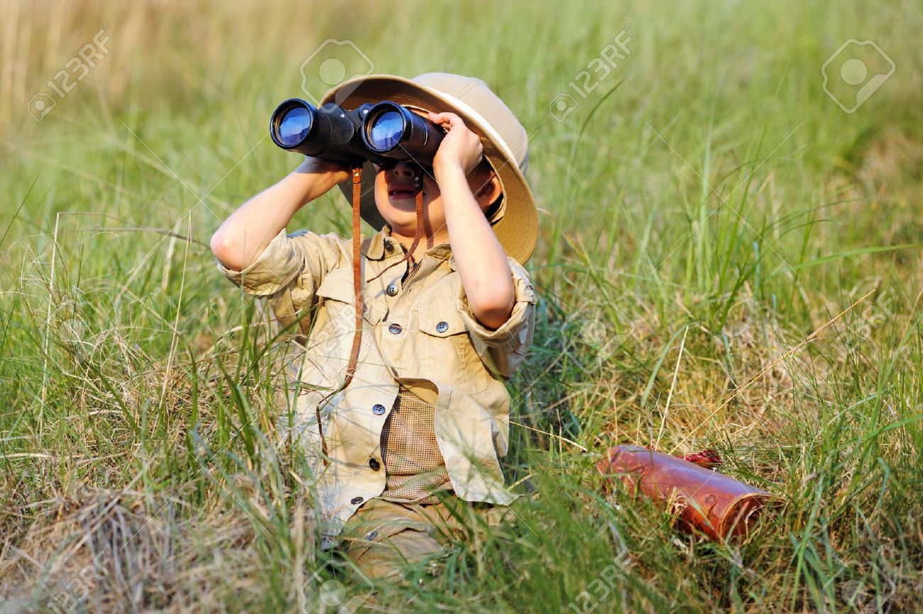 Young boy child playing pretend explorer adventure safari game outdoors with binoculars and bush hat Stock Photo - 14874064