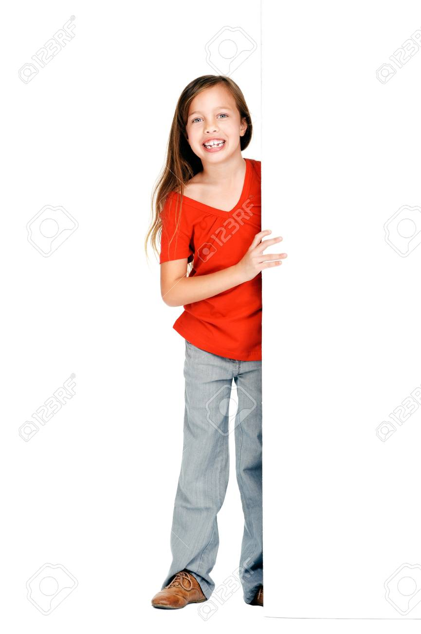 adorable little girl standing next to blank presentation board with copyspace isolated on white background Stock Photo - 16597231