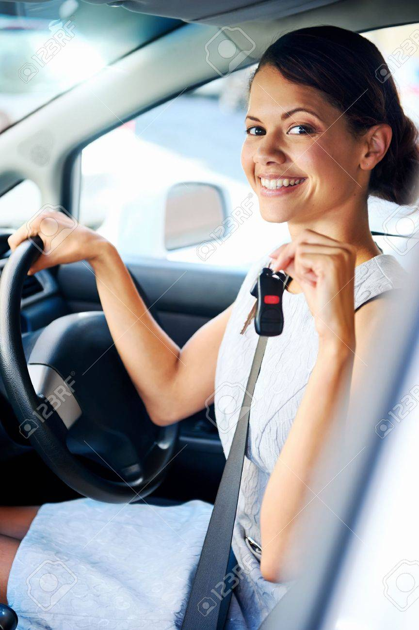 Happy woman new car owner smiling and showing keys in driver seat Stock Photo - 17644742