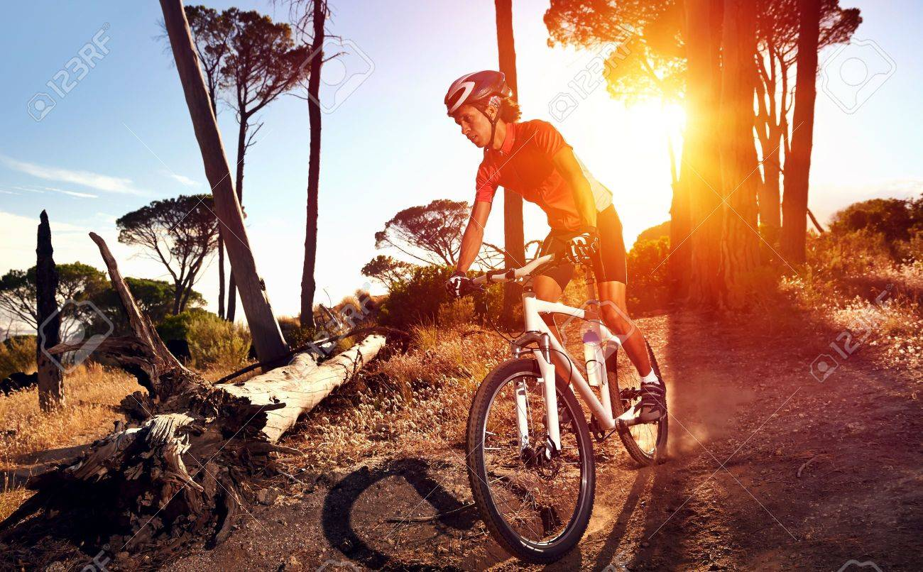 Mountain Bike Cyclist Riding Single Track At Sunrise Healthy Lifestyle  Active Athlete Doing Sport Фотография, картинки, изображения и  сток-фотография без роялти. Image 18630265.