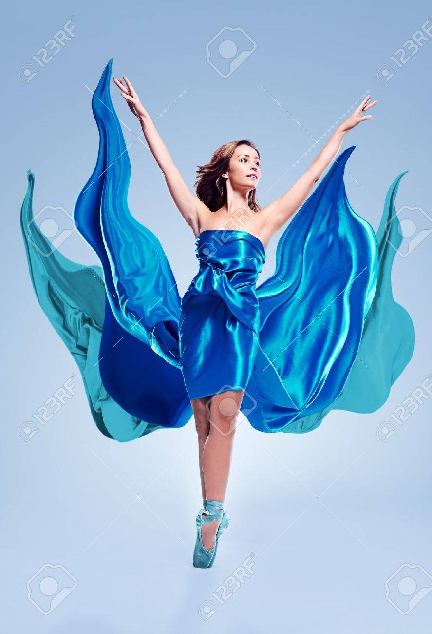 Beautiful ballet dancer with flowing blue fabric dancing with grace in studio Stock Photo - 18733558