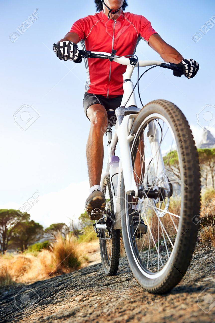 Extreme mountain bike sport athlete man riding outdoors lifestyle trail Stock Photo - 19109380