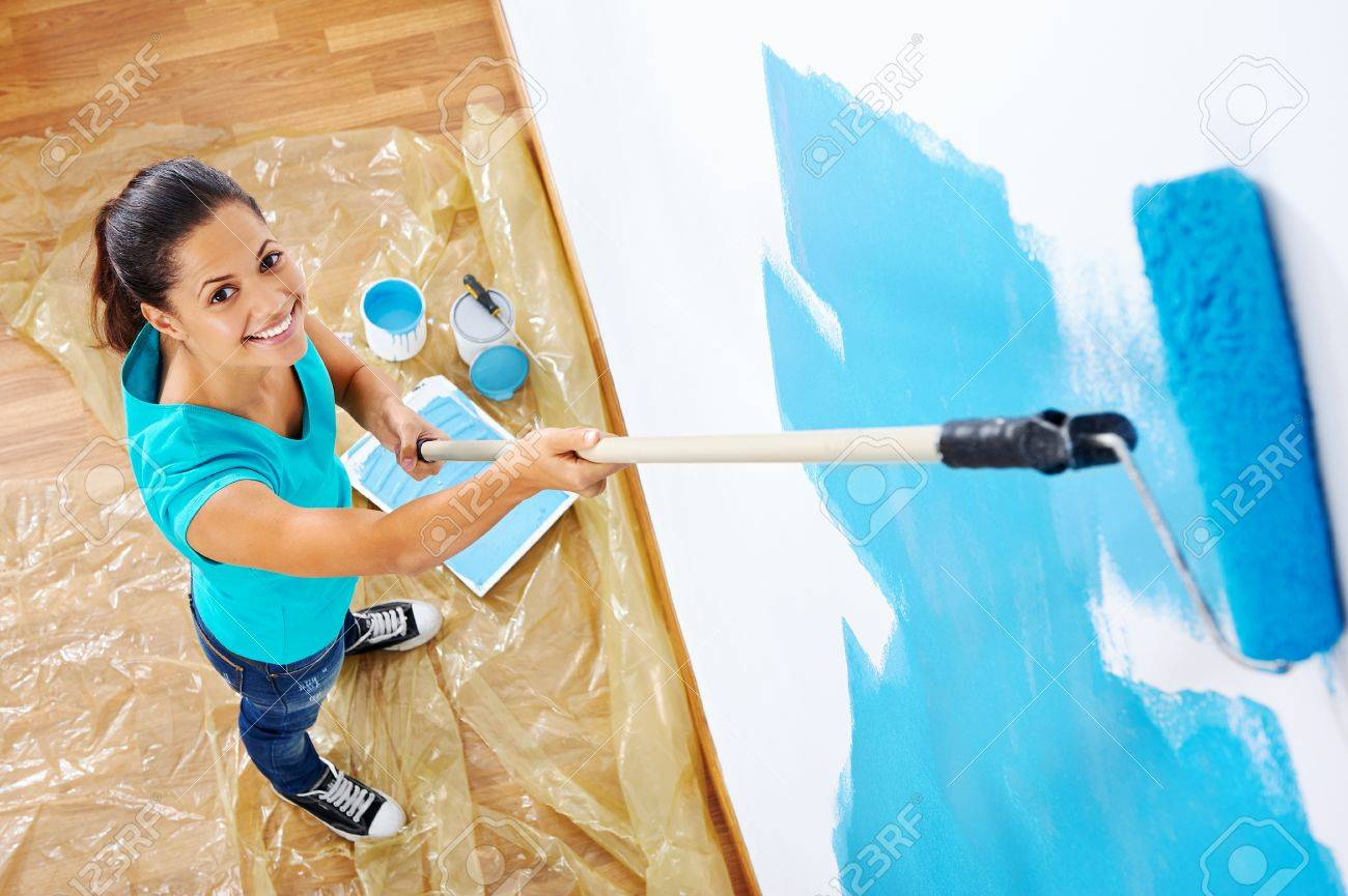 overhead view of woman painging new apartment standing on wooden floor Stock Photo - 20237674