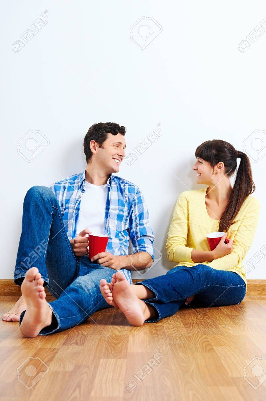 couple moving in to new home, empty floor Stock Photo - 20846346