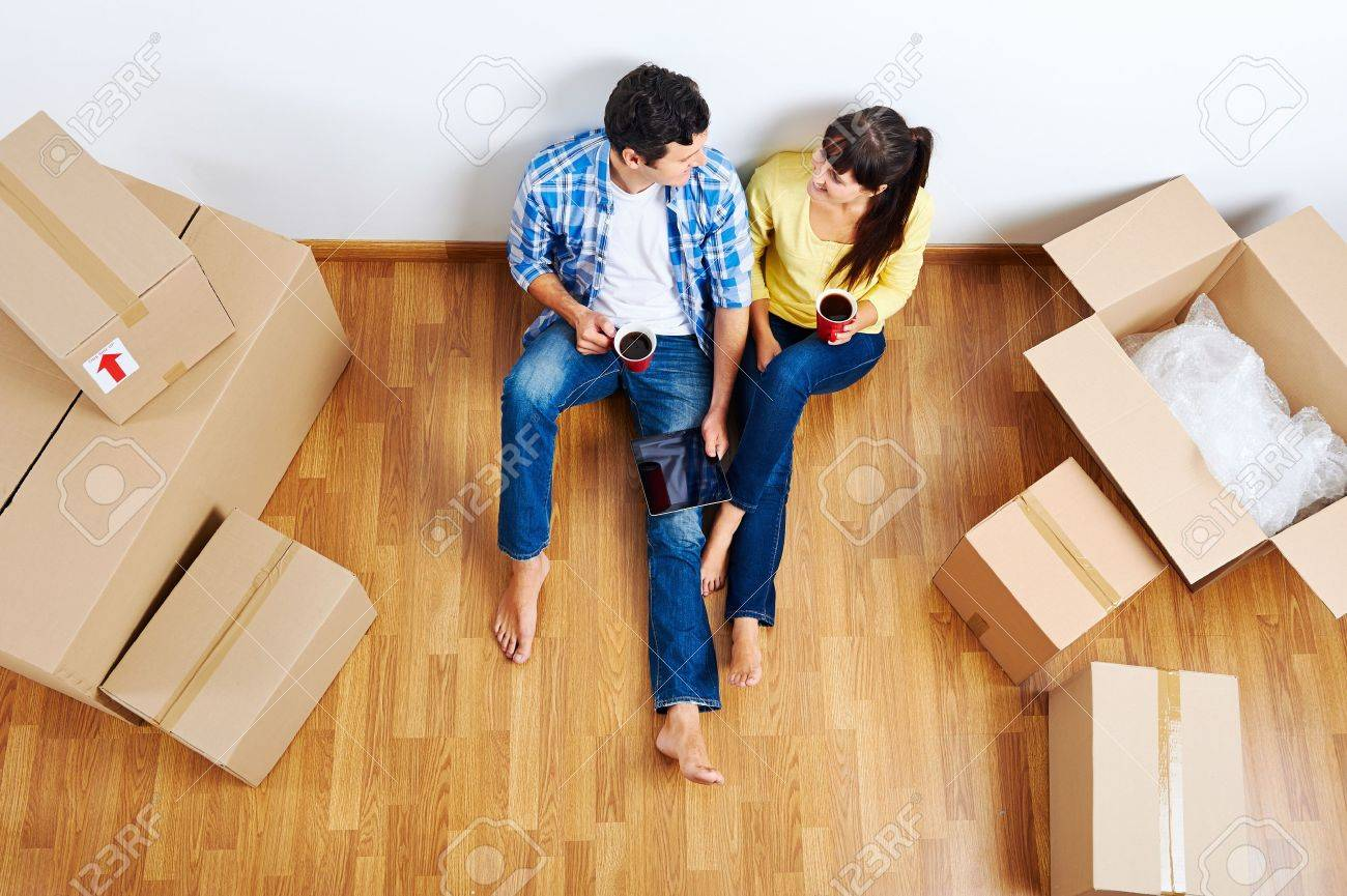 overhead view of couple moving in to new home and using wireless internet on tablet computer Stock Photo - 20863421