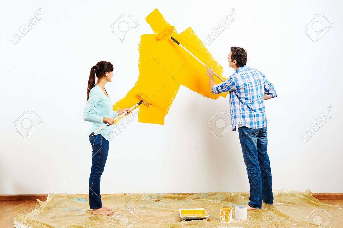 Renovation Diy Paint Couple In New Home Painting Wall Stock Photo ...