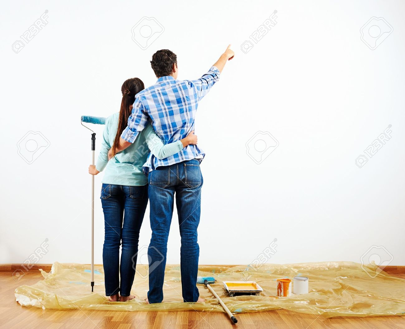 Renovation Diy Paint Couple In New Home Painting Wall Stock Photo   20904662