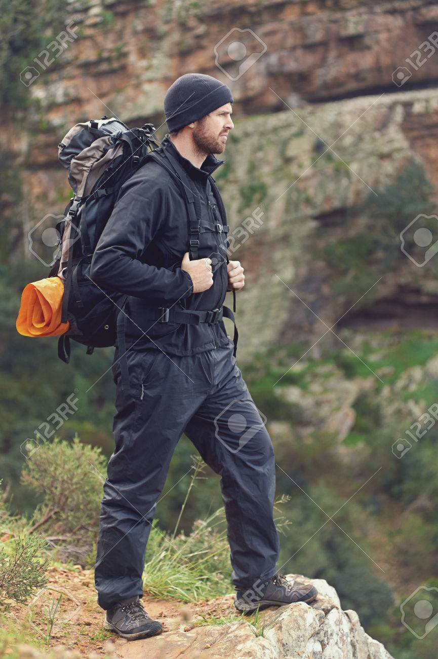 Adventure man hiking wilderness mountain with backpack, outdoor lifestyle survival vacation Stock Photo - 23032110