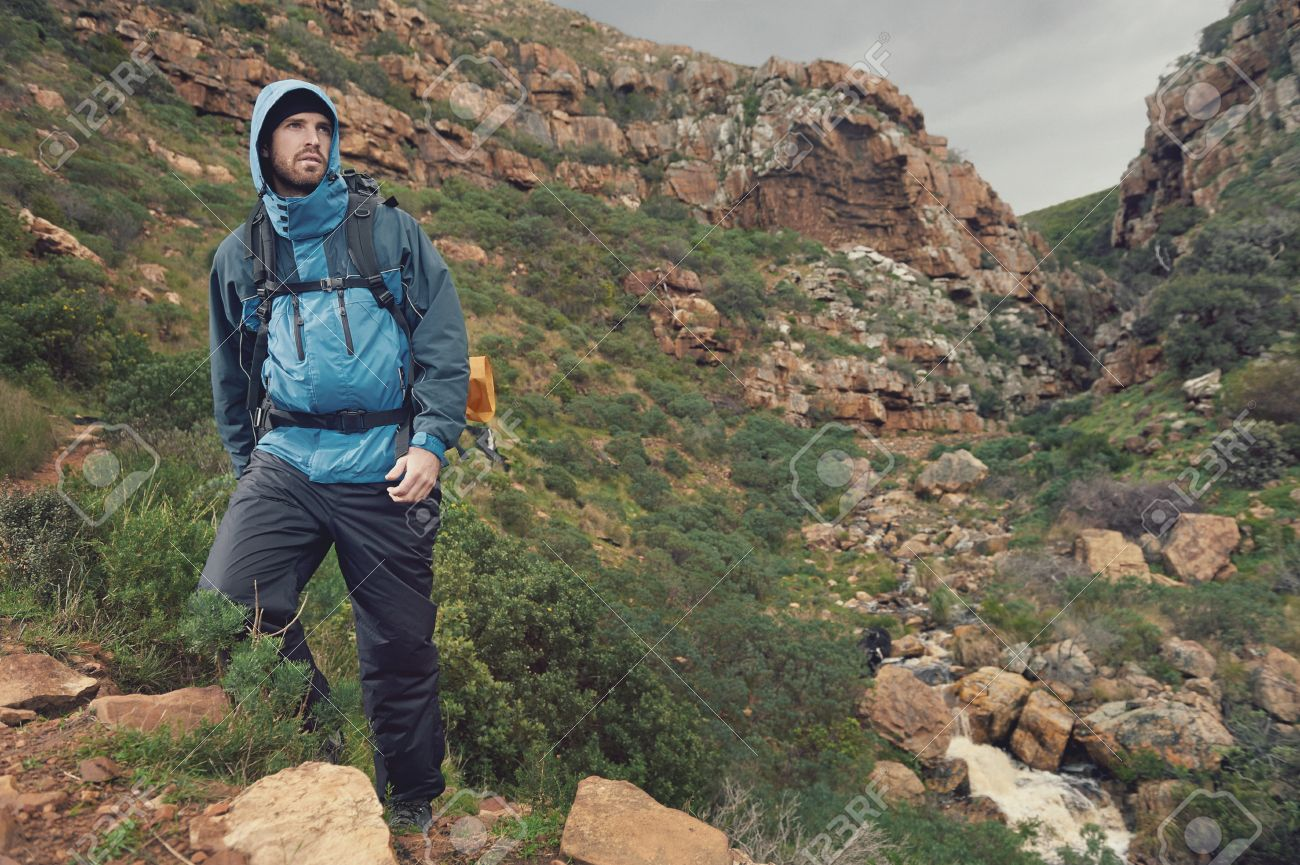 Adventure man hiking wilderness mountain with backpack, outdoor lifestyle survival vacation Stock Photo - 23032124
