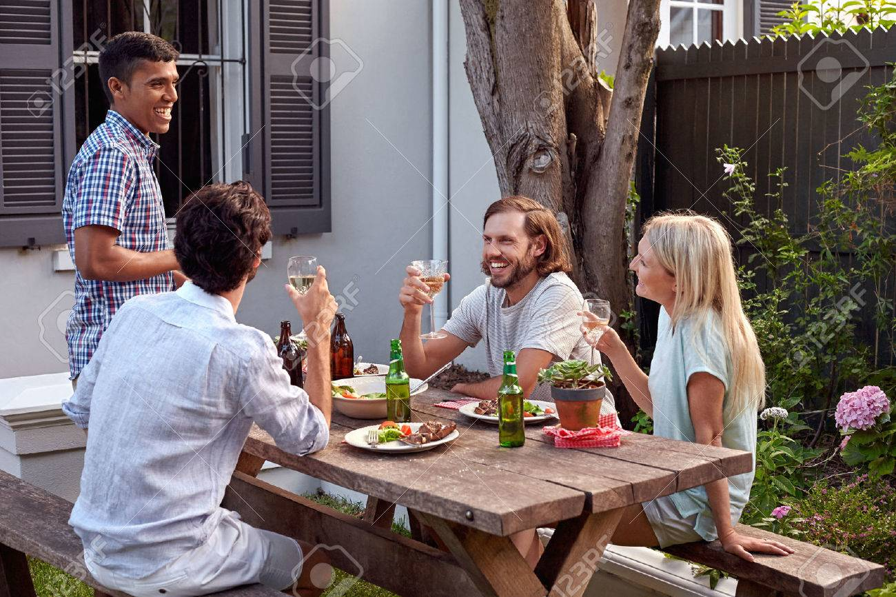 man toasting speech at friends outdoor garden party with wine drinks - 48917359