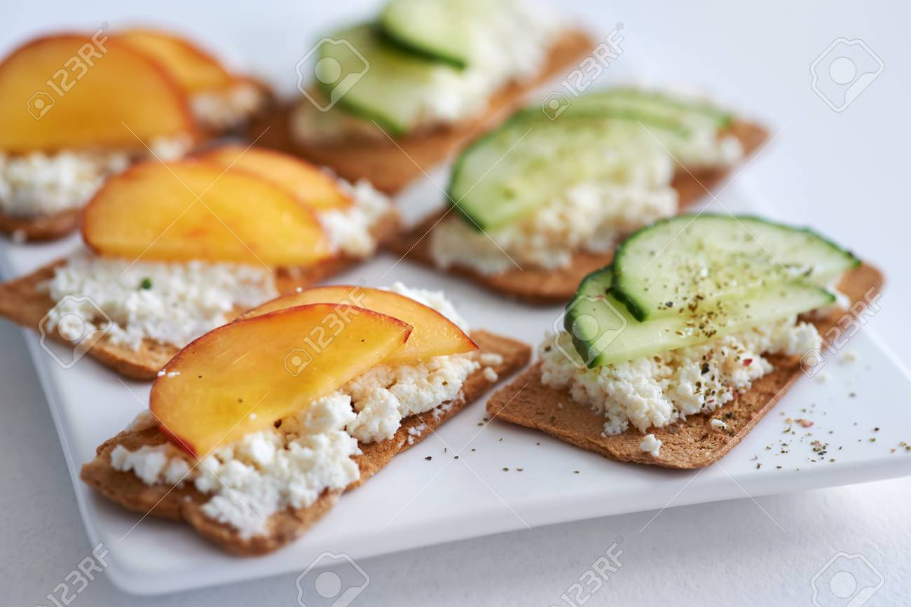 Fresh ricotta cottage cheese healthy snack starter platter appetiser fresh ricotta cottage cheese healthy snack starter platter appetiser with sliced peach nectarine and cucumber sisterspd