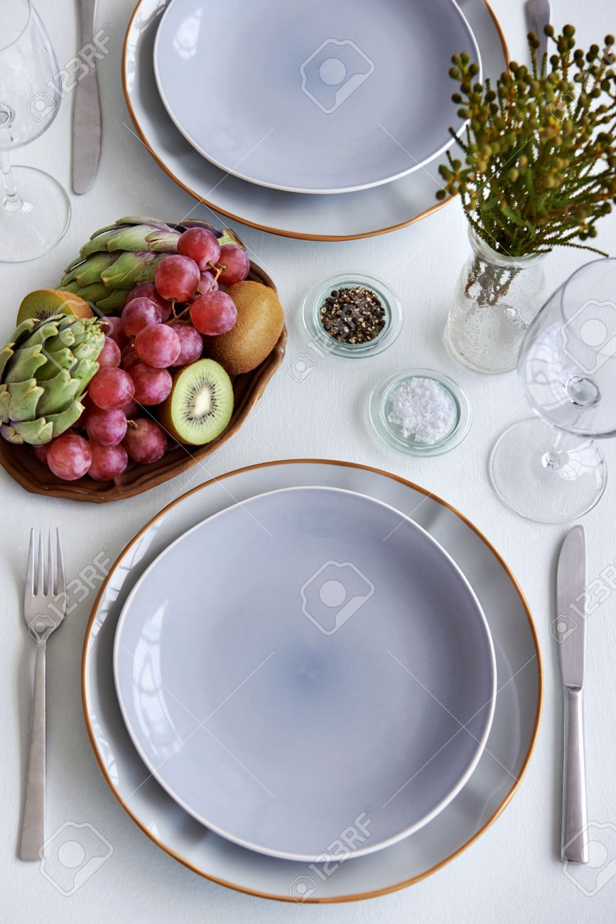 Simple elegant dinner table setting crockery cutlery and glasses using fresh fruit and vegetable kiwi & Simple Elegant Dinner Table Setting Crockery Cutlery And Glasses ...