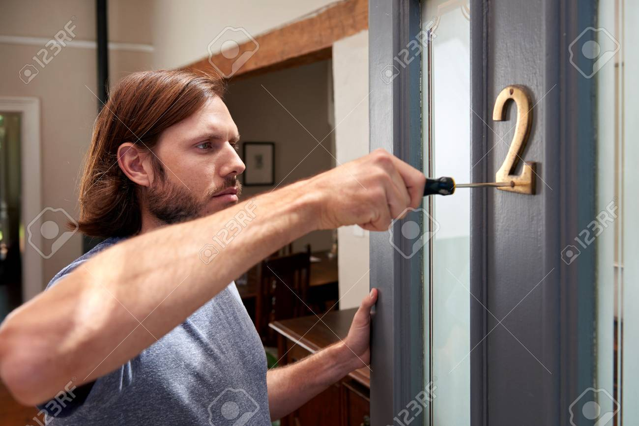 Young caucasian diy handy do it yourself man at home fixing things stock photo young caucasian diy handy do it yourself man at home fixing things up in the house solutioingenieria Image collections
